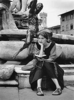 Sitting at Statue by Ruth Orkin